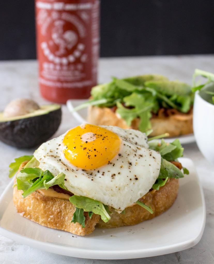 Open-Face Egg Sandwiches with Bacon, Avocado, & Sriracha Aioli