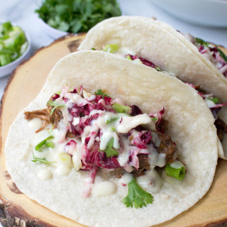Beer-Braised Beef Tacos with Radicchio Slaw & Horseradish-Cheddar Queso