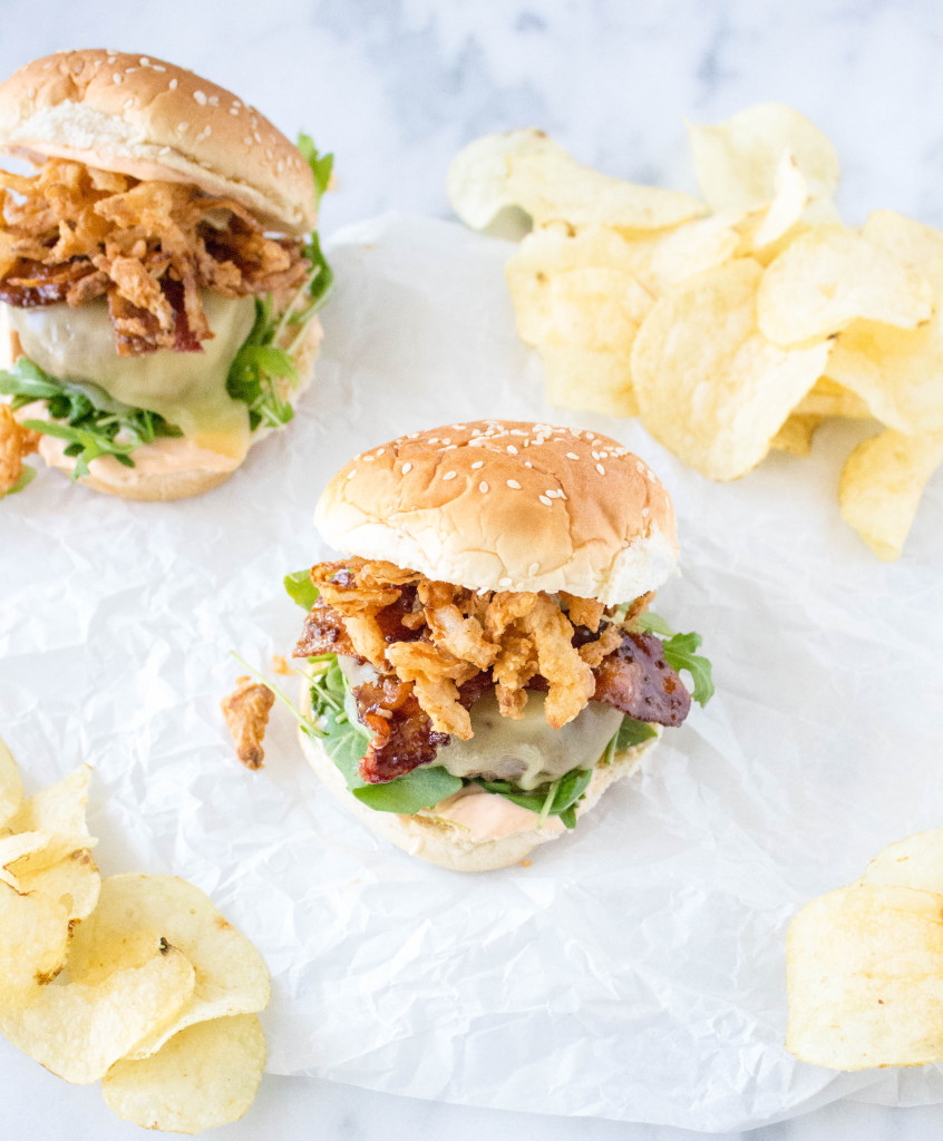 Cheeseburgers with Stout-Glazed Bacon, Crispy Onions, & Sriracha Aioli | yestoyolks.com
