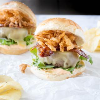 Cheeseburgers with Stout-Glazed Bacon, Crispy Onions, & Sriracha Aioli