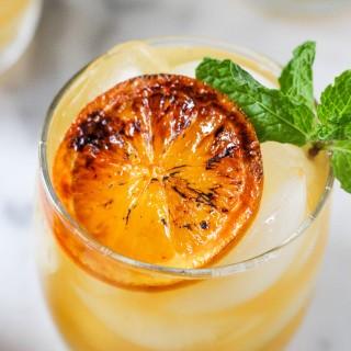 Boozy Clementine Lemonade with Brûléed Citrus & Mint
