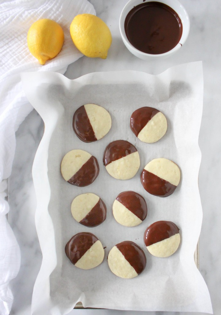 Lemon Truffle Cookies! Lemon cookies dunked in luxurious dark chocolate - the perfect little treat for your Valentine! | @yestoyolks.com