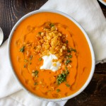 Creamy Roasted Red Pepper Soup with Crispy Fried Lentils | yestoyolks.com