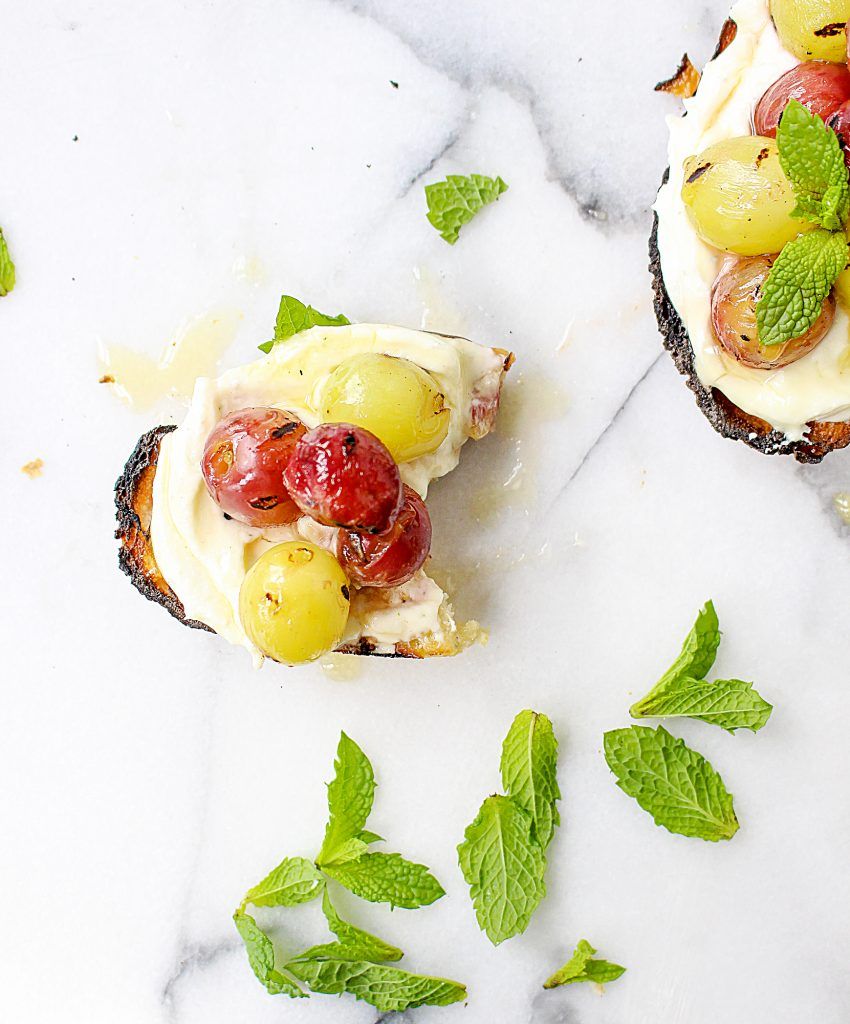 Grilled Grape Crostini with Honeyed Whipped Feta | yestoyolks.com