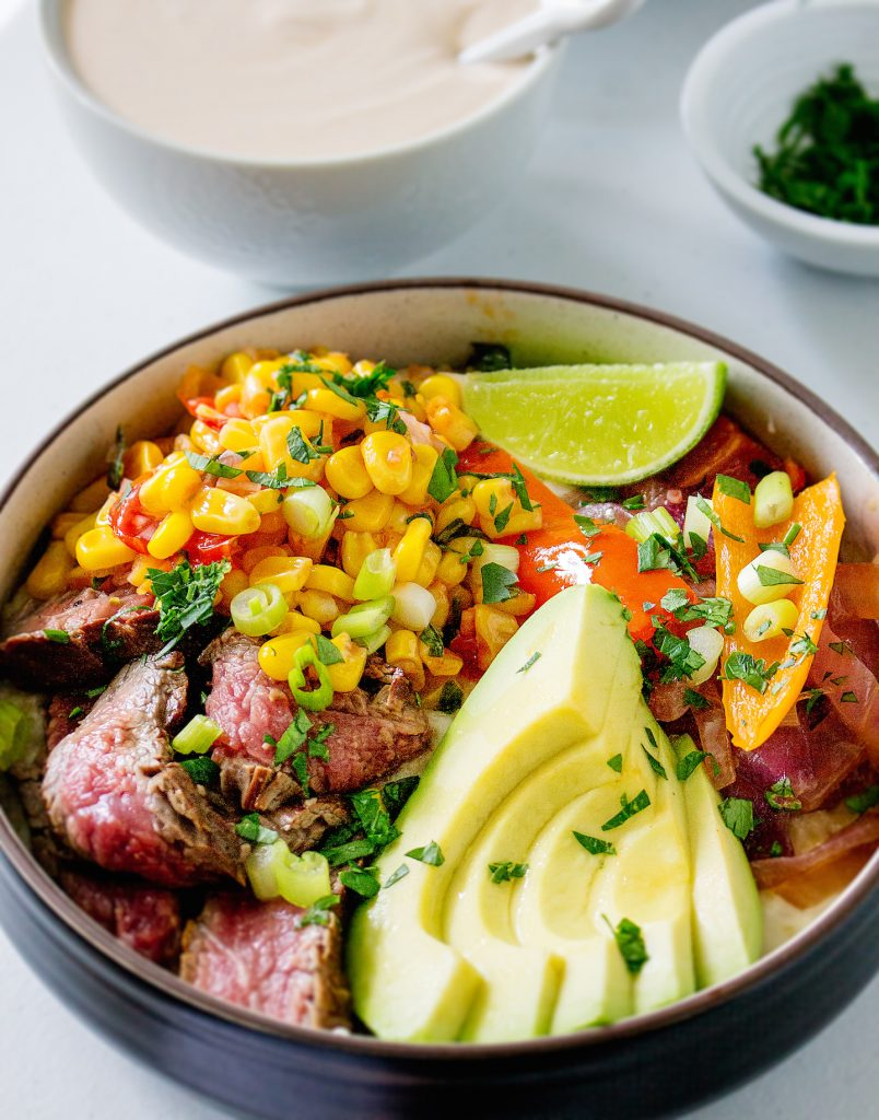 Cheddar Rice Bowls with Marinated Flank Steak, Corn, & Chipotle Drizzle   yestoyolks.com