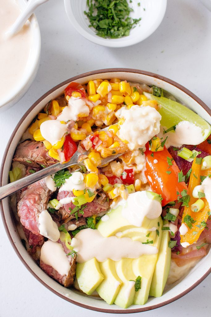 Cheddar Rice Bowls with Marinated Flank Steak, Corn, & Chipotle Drizzle | yestoyolks.com