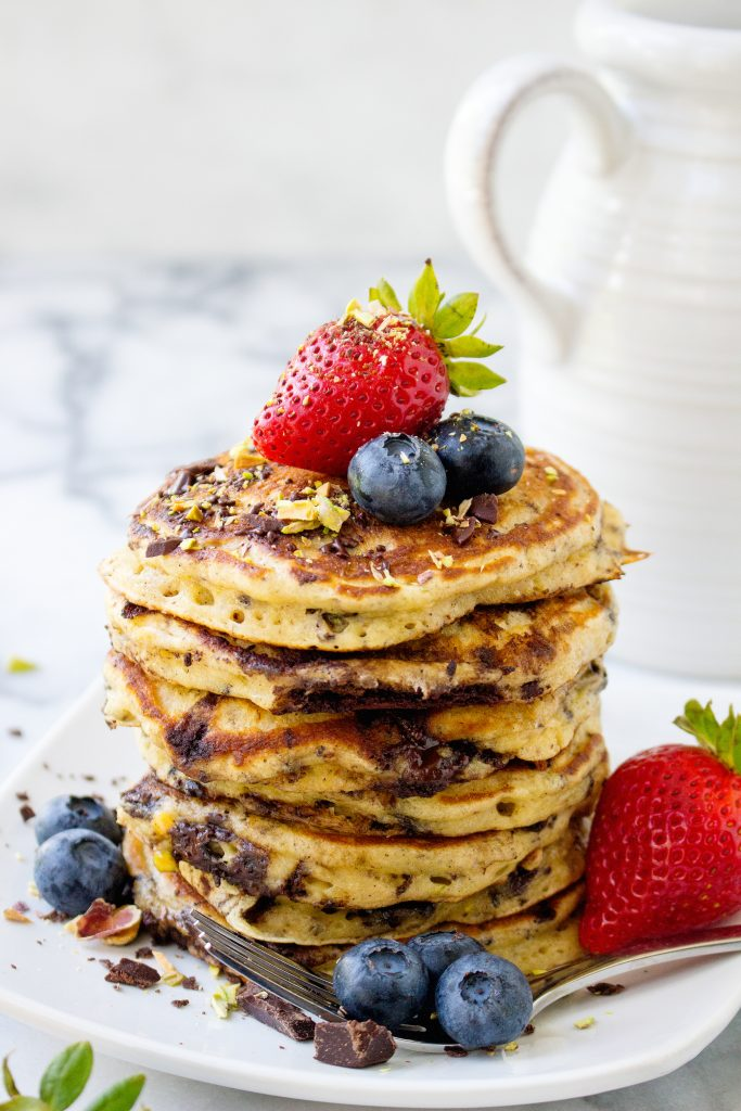 Dark Chocolate & Pistachio Pancakes with Fresh Berry Syrup | yestoyolks.com