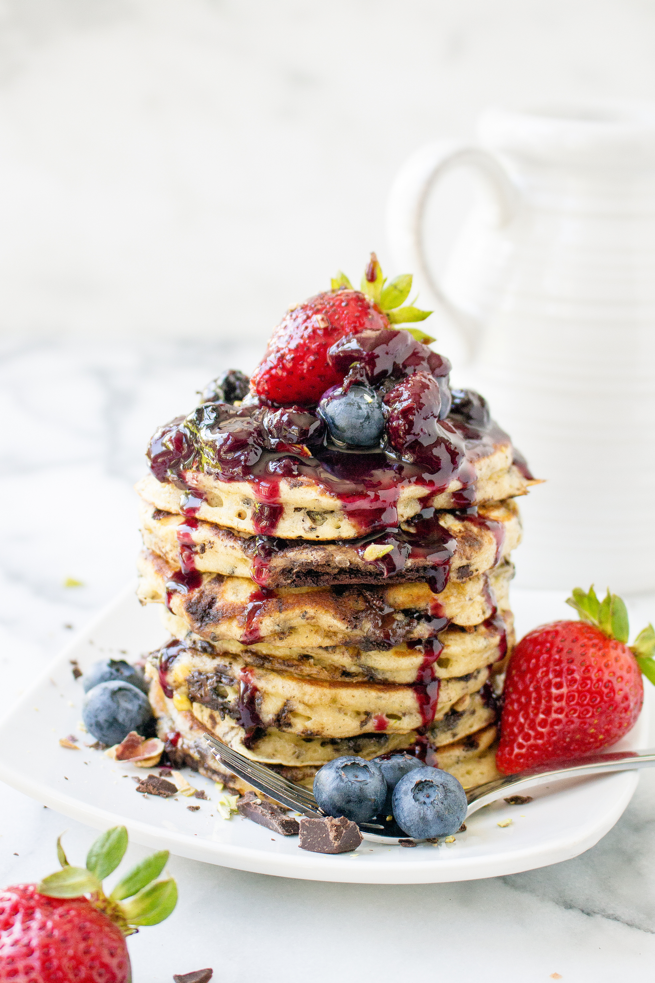 Dark Chocolate Pistachio Pancakes With Fresh Berry Syrup