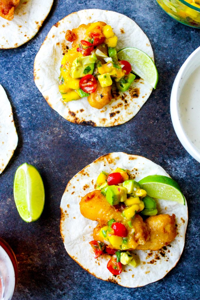 Beer-Battered Fish Tacos with Mango Avocado Salsa & Spicy Ranch Drizzle