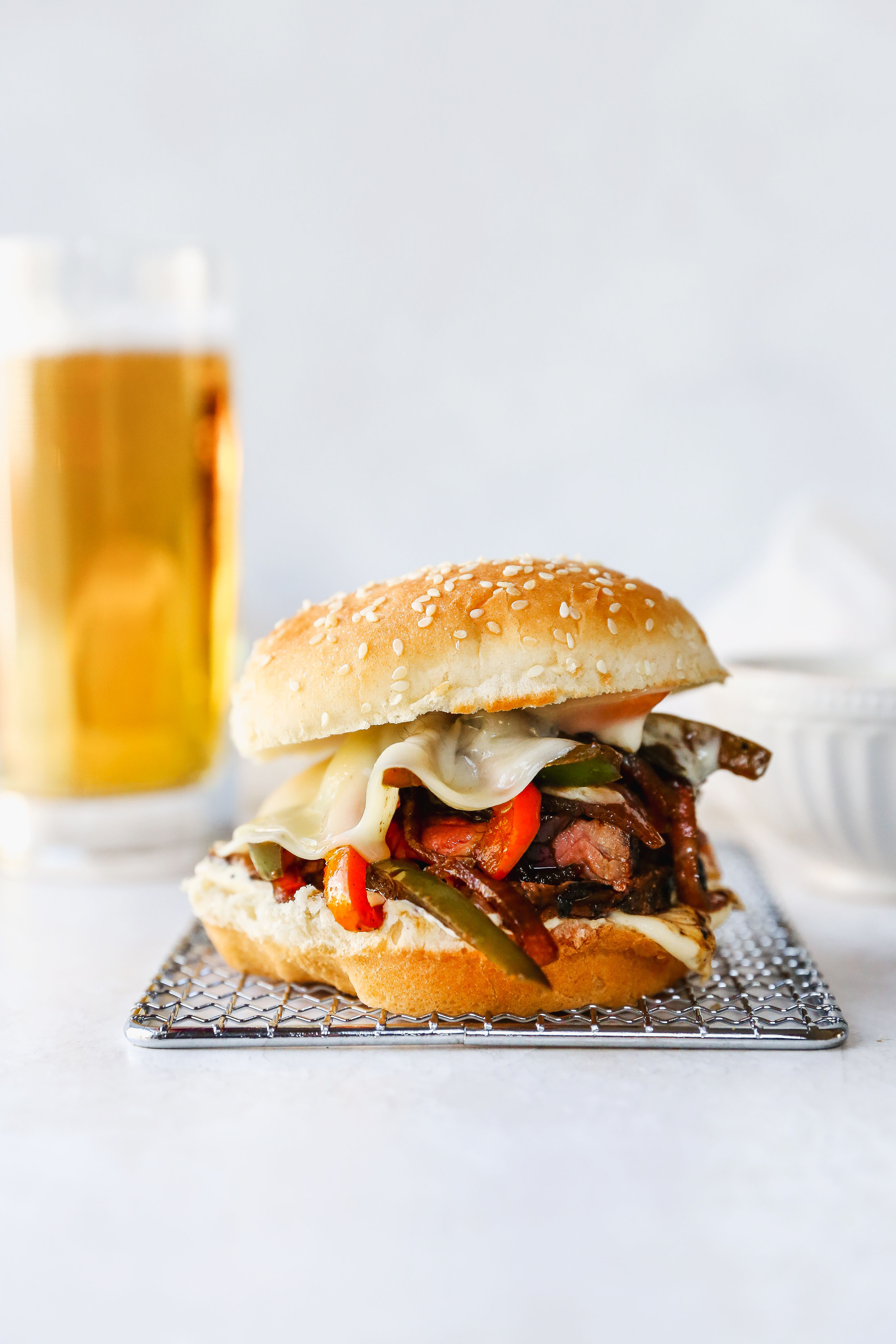 Guinness-Marinated Steak Sandwiches with Peppers, Onions, & Mustard Aioli