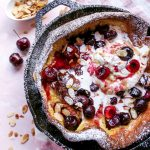 Roasted Cherry Dutch Baby with Amaretto Whipped Cream