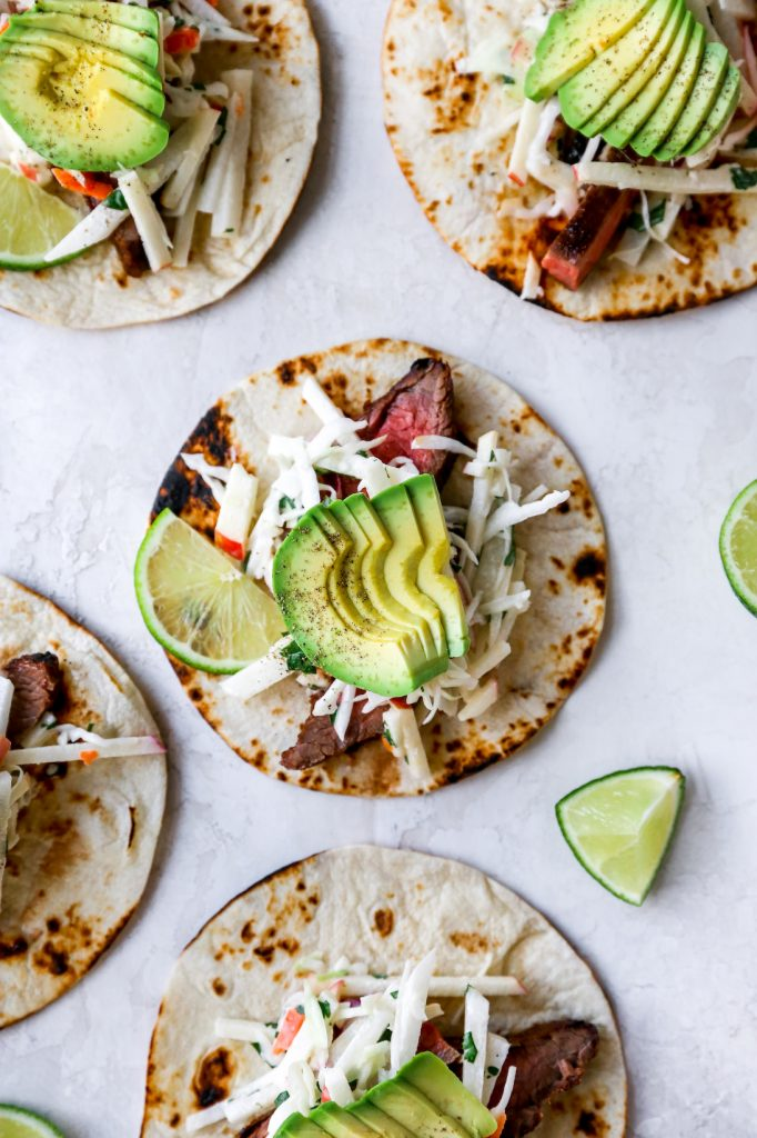 Spicy Flank Steak Tacos with Jicama-Apple Slaw